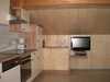 Wohnküche mit TV und Balkon (Ferienwohnung 2)